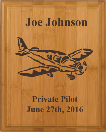 Personalized bamboo wood plaque with custom engraved airplane design and text.