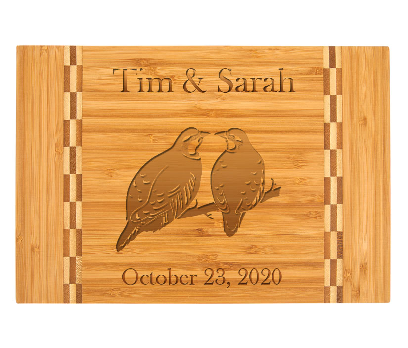 Personalized Bamboo Cutting Board with Engraved Bird Design.