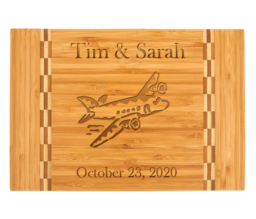 Personalized Bamboo Cutting Board with Engraved Airplane Design.