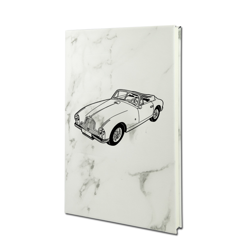 Personalized leatherette journal with custom engraved automobile design and text.