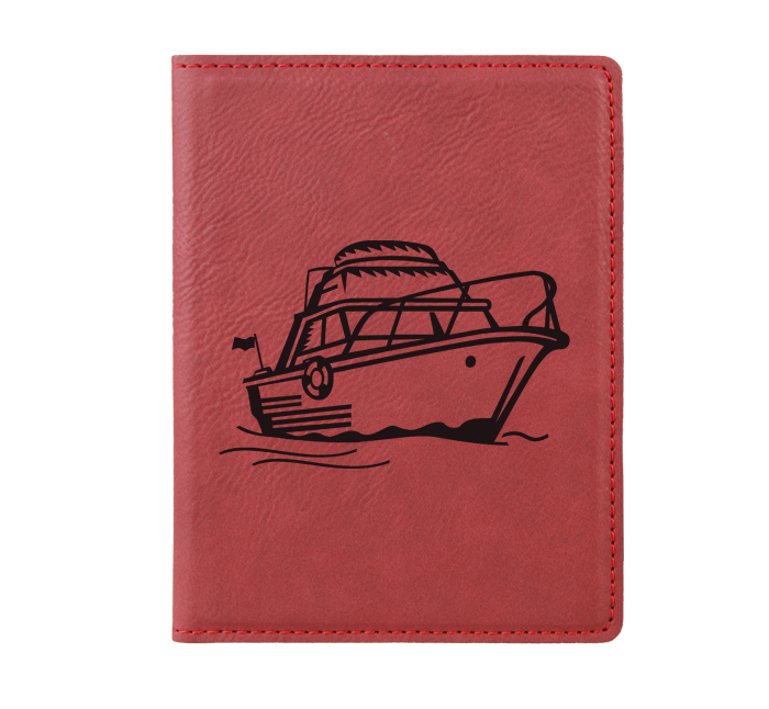 Personalized leatherette passport cover with custom engraved boat design and text.