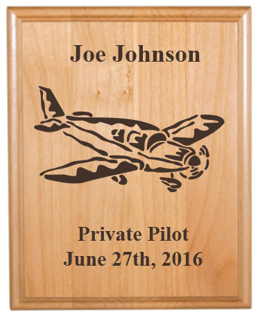 Personalized alder wood plaque with custom engraved airplane design and text.
