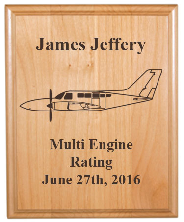 Personalized alder wood plate with custom engraved plane design and text.