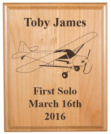 Personalized alder wood plaque with custom engraved plane design 2 and text.