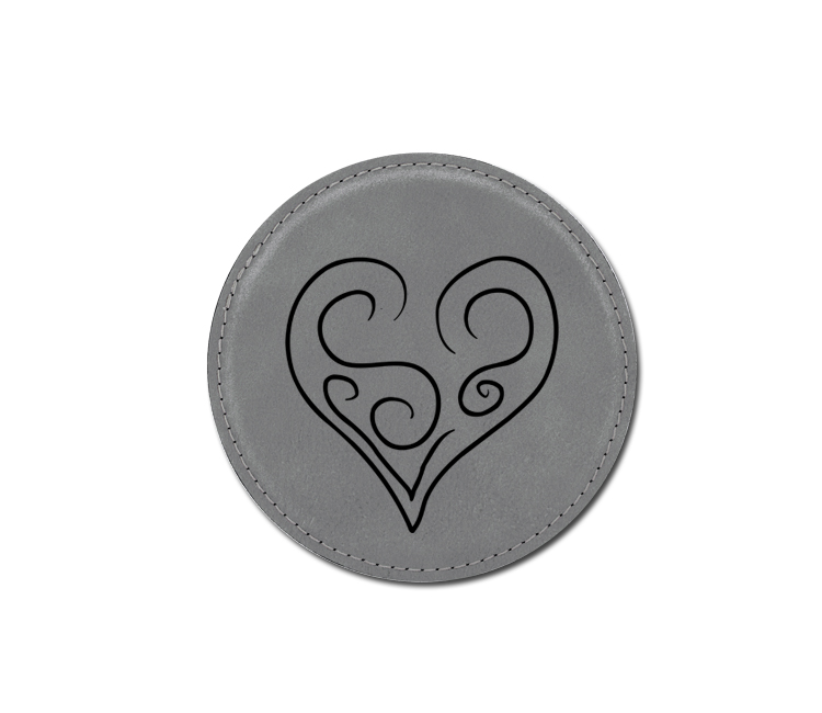 Personalized heart design leatherette coaster with custom engraved text.
