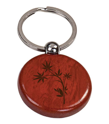 Personalized engraved wood key chain with custom engraved text and flower design 2.